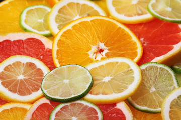 Wall Murals Slices of fruit Mix of citrus fruits cut in slices
