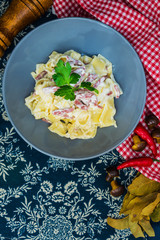 Pasta Torti with Carbonara and smoked bacon