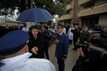 Abdelghani Hamel, former Director General of the Algerian National Police (DGSN), greets a police officer in Algiers