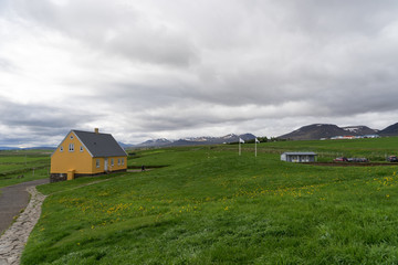 Traditional icelandic wooden yellow House in Iceland