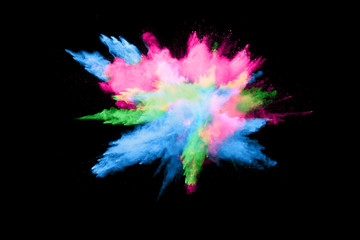 color powder explosion cloud isolated on black background. Freeze motion of color dust  particles splashing.