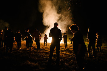 Group of people around a large bonfire Wall mural