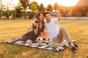 Young cute loving couple take a selfie by mobile phone.