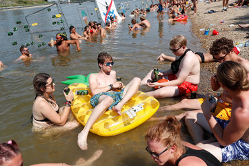 Festivalgoers cool themselves in the Danube River during the Sziget music festival on an island in Budapest