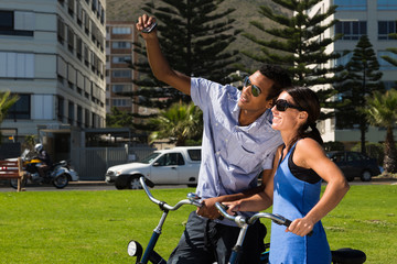 Urban Couple Take Photo of Themselves with Bicycles