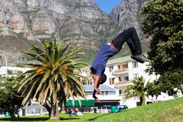 Man Doing Backward Somersault in a Park