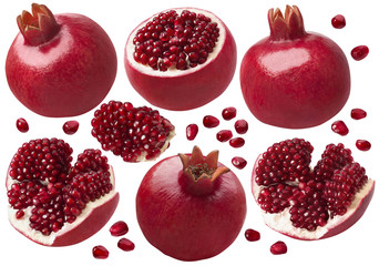 Pomegranate whole and pieces set. Isolated on white background