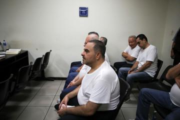 El Salvador's former President Elias Antonio Saca waits at his hearing on corruption charges in San Salvador