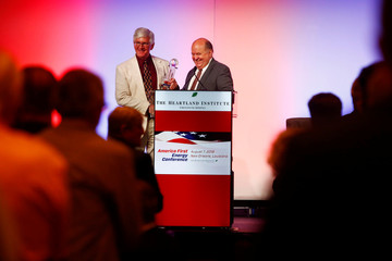 Roy Spencer, principal research scientist at the University of Alabama, Huntsville, accepts an award from Kenneth Haapala, President of the Science and Environmental Policy Project  during the America First Energy Conference 2018 in New Orleans