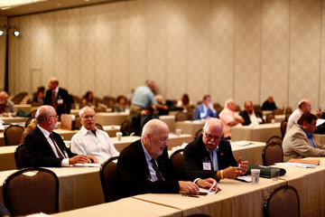 Attendees talk during the America First Energy Conference 2018 in New Orleans