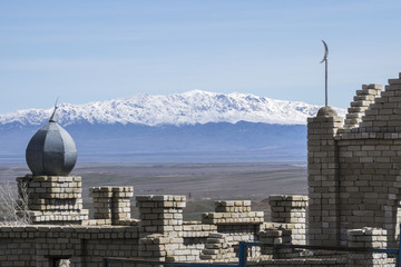 Kazakhstan, Muslim cemetery with Mountains in background