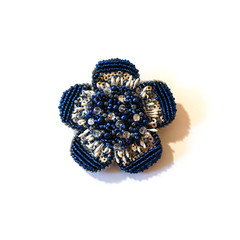 Blue brooch in the form of a flower from beads and sequins.