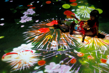 Children play at a digital installation in New Taipei City