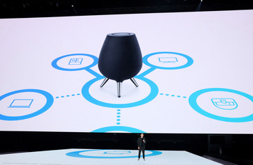 Ji Soo Yi, Samsung's Vice President of AI Strategy describes the new Samsung Home smart speaker during a product launch event in Brooklyn, New York