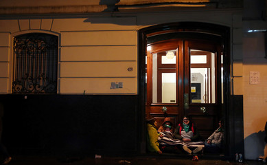 Abortion rights activists wait outside the Congress as senators vote on a bill to legalize abortion, in Buenos Aires