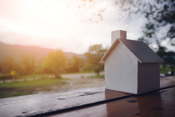Model white house placed on wood. Natural background Vintage style
