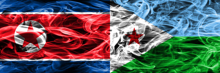 North Korea vs Djibouti smoke flags placed side by side