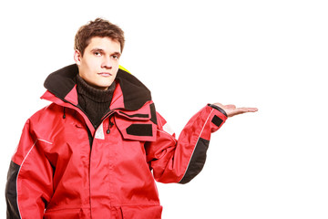 Adventurous man making gesture