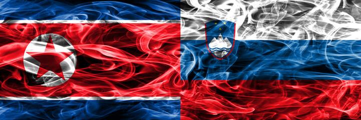 North Korea vs Slovenia smoke flags placed side by side