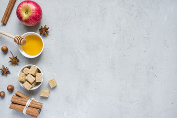 Honey and Apple, brown sugar and anise with cinnamon on a light background copy space for text.