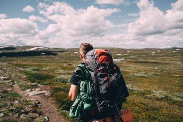 Man hiking a mountain trail