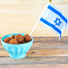 Israel flag and Falafel balls in a bowl on wooden  background. Falafel-Traditional Israeli food.Copy space for text.