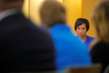 D.C. Mayor Muriel Bowser listens during a meeting with faith leaders in Washington