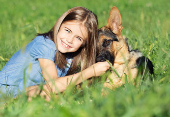 puppy and girl in the grass