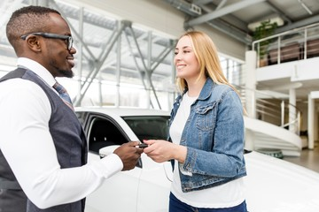 African seller gives the buyer the keys to the new car