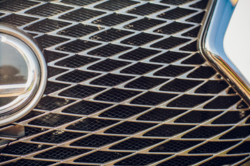 Modern luxury car close-up grille. Background, concept expensive, sports auto detailing