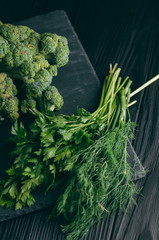 Acrylic Prints Rice fields On a dark wooden table, fresh green broccoli, parsley, dill for your health. Flatlay. Recipe. Ingredients. Dietary food. Place under the text.