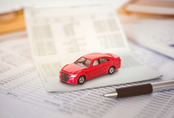 Car expenses calculator, payments  costs with paper notes, payments table,dollar money and toy car. Financial and Installment payment concept.