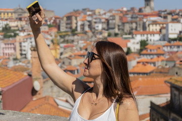 woman doing a selfie in Porto, Portugal.