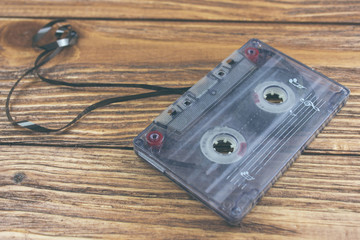 old cassette on a wooden table