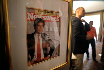 A framed Newsweek magazine cover of U.S. President Donald Trump hangs on the wall of the Trump National Golf Club Bedminster clubhouse in Berkeley Heights, New Jersey