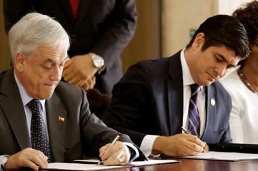 Costa Rica's President Carlos Alvarado and Chile's Sebastian Pinera sign bilateral agreements at the Presidential house in San Jose