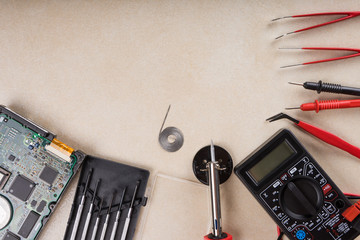 Fotobehang Retro Multimeter, soldering tool and hand tools for electronics assembly. Copy space.