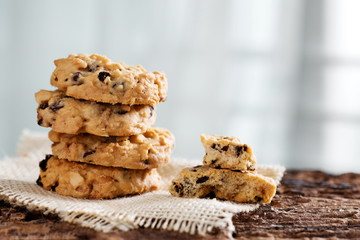 Pile of chocolate chip cookies on sackcloth.