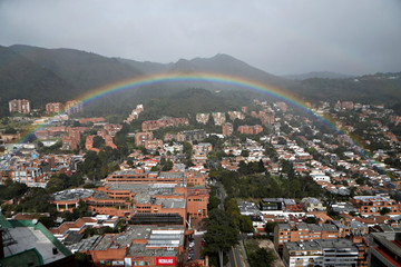 A rainbow appears over the eastern hills in Bogota