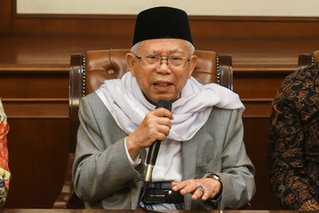 Islamic cleric Ma'ruf Amin speaks to the media after he was chose to be Indonesian Presiident Joko Widodo's running mate in the 2019 presidential election in Jakarta,