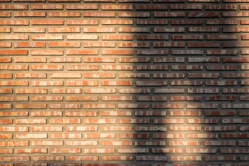 White brick wall with textures at sunset.