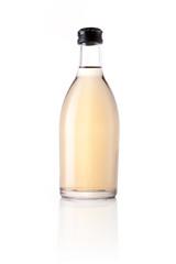 yellow soda bottle isolated white.