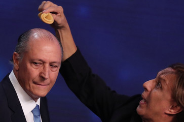 Presidential candidate Geraldo Alckmin of Brazilian Social Democratic Party (PSDB) gets a touch up from a network makeup artist during the first television debate at the Bandeirantes TV studio in Sao Paulo
