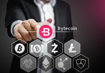 Business man points his finger at  Bytecoin coin  icon  among others Cryptocurrency on Virtual Touch Screen , Conceptual