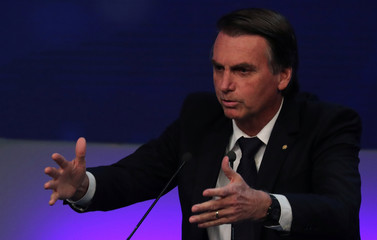 Presidential candidate Jair Bolsonaro of the Party for Socialism and Liberation (PSL) attends the first television debate at the Bandeirantes TV studio in Sao Paulo