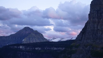 Wall Mural - Fast Motion Clouds Move Over Mountains Glacier National Park