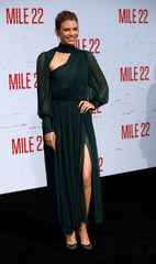 "Cast member Cohan poses at the premiere for ""Mile 22"" in Los Angeles"