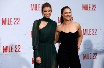"Cast members Cohan and Rousey pose at the premiere for ""Mile 22"" in Los Angeles"