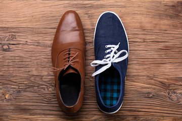 Elevated View Of Two Different Shoe