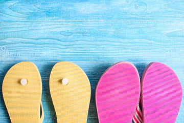 Rubber slippers on a wooden background